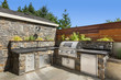 Home exterior backyard hardscape outdoor entertainment and cooking area with barbecue