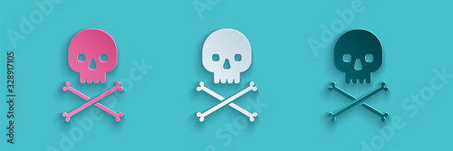 Paper cut Skull on crossbones icon isolated on blue background Canvas Print