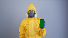 A Man In Yellow Hazmat Suits A...