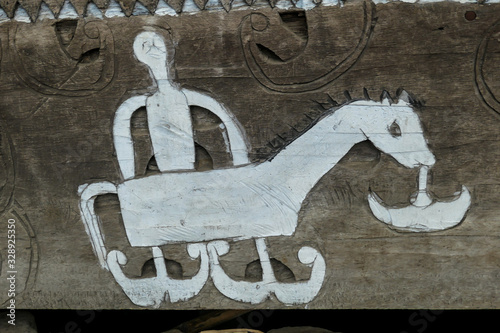 A drawing of a horse, man and a boat on the house's stairs in traditional Bena village in Bajawa, Flores, Indonesia Принти на полотні