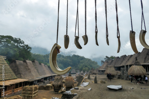 Horns of different animals hanging below the rooftop of house in traditional Bena village in Bajawa, Flores Indonesia Фотошпалери
