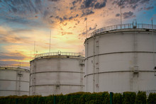 Big Industrial Oil Tanks In A Refinery Base. Sunset Sky