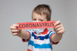 canvas print picture - Young child wearing a respiratory mask as a prevention against the Coronavirus Covid-19