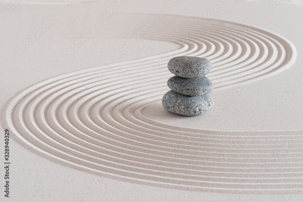 Fototapeta Japanese zen garden with stone in textured white sand