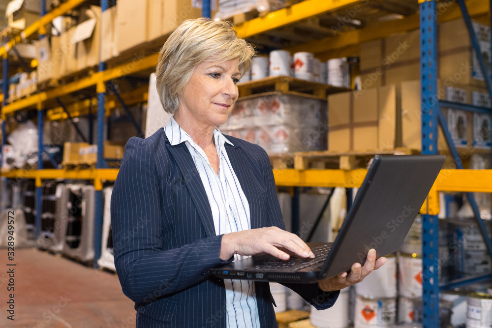 Fototapeta warehouse manager holding a laptop