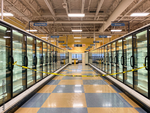 Photo Empty Grocery Store Freezer Aisle With Caution Tape Blocking Entrance