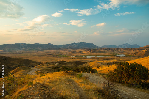 Summer Evening Landscape On Cape Meganom In Crimea, Russia. #328956549