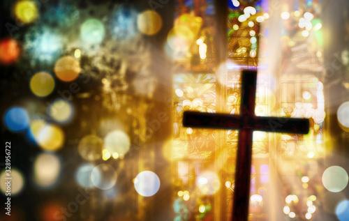 Obraz na plátně Deliberately blurred cross inside a church