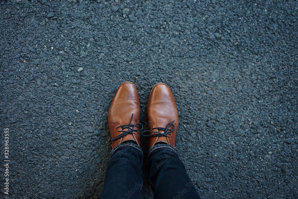 Fototapeta feet in shoes on floor