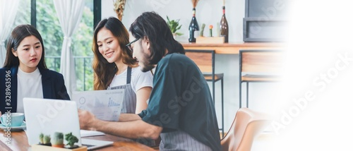 Asian business women talking about business plan with the coffee shop owner and barista in cafe background.Small business finance concepts For the new generation who wants to startup business.
