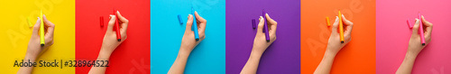 Female hands with felt-tip pens on colorful background