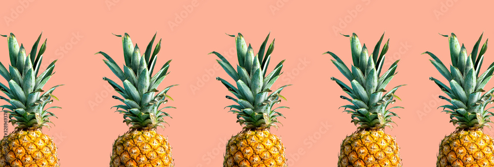 Fototapeta Many pineapples on a solid color background
