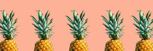 Many Pineapples On A Solid Col...