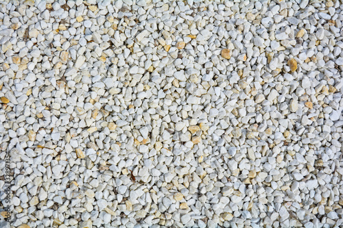 Small White and yellow pebble background. Top view of gravel stone texture