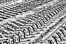 Grunge Texture Of Vehicle Tire Tracks. Monochrome Background Of Traces Of Truck On A Dirt Road. Overlay Template. Vector Illustration