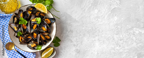 Fotografiet Delicious and healthy steamed mussels on white background