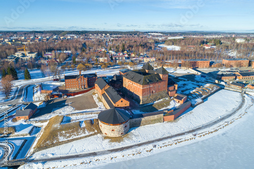 The ancient fortress of the Hameenlinna city against the backdrop of the cityscape on a sunny March day (aerial photography) Canvas Print