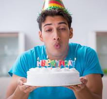Young Man Celebrating Birthday...
