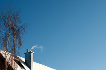 Rooftop With Smoking Chimney C...