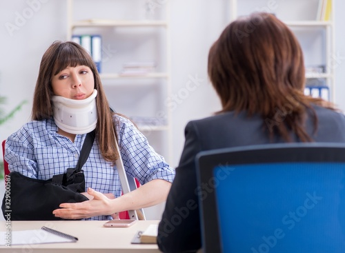 Injured employee visiting lawyer for advice on insurance Wallpaper Mural