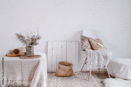 Fototapeta Bright interior of a cozy room with a chair and home decor. obraz