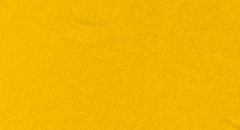 Vibrant Yellow Texture Of Binding Fabric. Yellow Textile Background With Natural Folds. Close-up