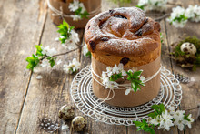 Traditional Orthodox Easter Bread Kulich,  Rustic Wooden Background