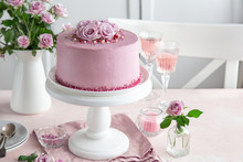 Festive Pink Cake On White Cake Stand Decorated With Fresh Roses For Valentines Day
