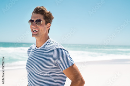 Fototapeta Happy man smiling at beach obraz