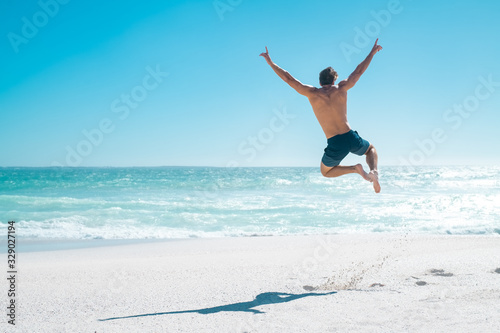Jumping in joy for vacation Fotobehang