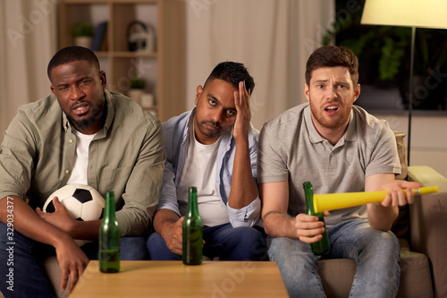 friendship, sports and entertainment concept - disappointed male friends or foot Fototapet