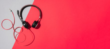 Music And Sound Concept. Style Black Headphones On Grey And Red Background. Top View. Copy Space. Urban Summer Time