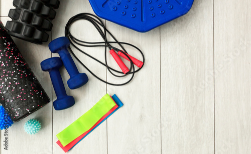 A lot of different fitness and sport accessories and equipment on the wooden flo Fototapet