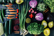 Top View Of Set Vegetables On A Black Background With Chili, Carrots, Tomatoes, Beans, Green,red,red Onions, Lettuce,pepper, Pumpkin, Cinnamon, Cauliflower, And Avocados. Healthy Concept