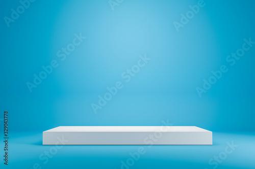 Fototapeta White podium shelf or empty studio display on vivid blue summer background with minimal style