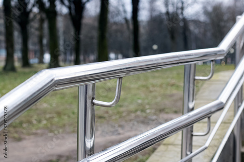 Fényképezés Metal railing stairs in the park close up