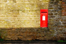 English Post Box On Stone Wall...