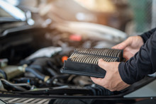 Professional Mechanic Man Holding Air Filter Of A Car For Repair And Preventive Maintenance Car In Garage
