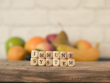 The Words Immune System On Small Wooden Blocks, Healthy Eating Concept