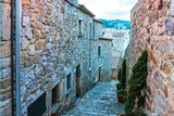 Fototapeta Uliczki - Tossa de Mar, Spain, August 2018. Narrow old street in the city fortress.