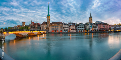 Panoramic view of famous Fraumunster church, Munsterbrucke bridge and river Limmat at sunset, Old Town of Zurich, the largest city in Switzerland