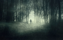 Man In Dark Scary Forest At Ni...
