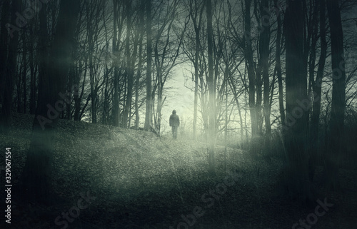man in dark scary forest at night Canvas Print