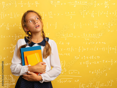 Young student is with shocked expression and think about complex exercises Canvas Print