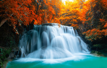 Fototapeta Woda Krople Beautiful waterfall with sunlight in autumn forest at Erawan National Park, Thailand, Nature landscape , Beautiful steam green forest nature