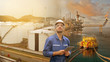Caucasian man engineer staff worker with tablet in hand and refinery background concept.