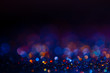 canvas print picture - Festive bokeh glitters background, abstract blurred backdrop with circles,modern design wallpaper with sparkling glimmers. Black, blue and golden backdrop glittering sparks with blur effect