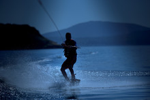 Silhouette Of A Wakeboarding A...