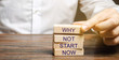 Businessman puts wooden blocks with the words Why not start now. Motivation, inspiration concept. Achievements of goals
