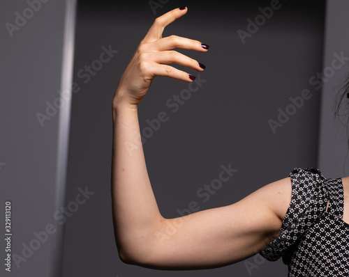 Well toned arm forearm hand of a young white woman Fototapete